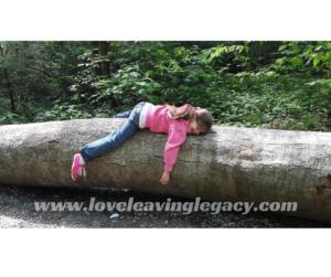 Anna on a log